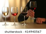 man holding a glass of red wine ... | Shutterstock . vector #414940567