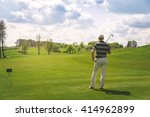 male golfer standing at fairway ... | Shutterstock . vector #414962899