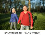 happy seniors couple hold hands ... | Shutterstock . vector #414979804