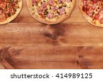 wooden table with pizza top... | Shutterstock . vector #414989125