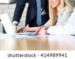 business colleagues working... | Shutterstock . vector #414989941