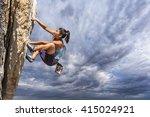 female climber dangles from the ... | Shutterstock . vector #415024921