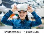 woman wearing virtual reality... | Shutterstock . vector #415069681