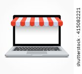 open laptop with striped awning.... | Shutterstock .eps vector #415082221