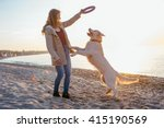Female With Retriever Dog...