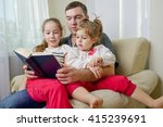 father with daughter at home | Shutterstock . vector #415239691