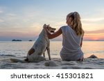 Young Woman With Dog Sitting O...