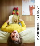 girl lying on bed and reading... | Shutterstock . vector #41540794