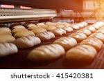 dessert bread baking in  oven....   Shutterstock . vector #415420381