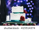 white wedding cake and candles... | Shutterstock . vector #415514374