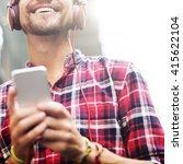 man walking listening music... | Shutterstock . vector #415622104