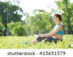 woman meditating in park   Shutterstock . vector #415651579