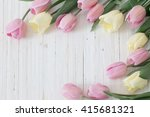 beautiful tulips on wooden... | Shutterstock . vector #415681321