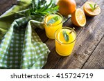 orange juice in glass with mint ... | Shutterstock . vector #415724719