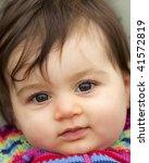 Beautiful Baby Girl Looking At...