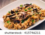 wild mushrooms risotto with... | Shutterstock . vector #415746211