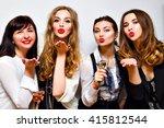 four pretty woman sending air... | Shutterstock . vector #415812544