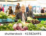 woman buying fruits and... | Shutterstock . vector #415826491
