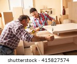 two carpenters working at... | Shutterstock . vector #415827574