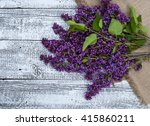 lilac flowers on old wooden... | Shutterstock . vector #415860211