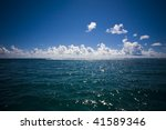 horizon with clouds at sea - stock photo