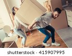 young couple carrying big... | Shutterstock . vector #415907995