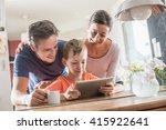 a modern family using a laptop... | Shutterstock . vector #415922641