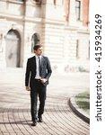 stylish businessman walking... | Shutterstock . vector #415934269