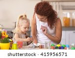 mother and daughter decorating... | Shutterstock . vector #415956571