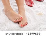 Woman's Feet In The Sand With...