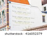 Small photo of Leiden, Netherlands - April 7, 2016: Velimir Khlebnikov poem at the wall of house in Leiden, Holland. The city of Leiden is decorated throughout with 101 'wall poems'