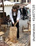 Small photo of LEIPZIG, GERMANY - CIRCA MARCH 2016: rastaman wood worker showing old times jobs