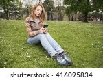 woman texting on a smart phone  ... | Shutterstock . vector #416095834