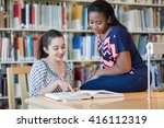 two beautiful girls studying in ... | Shutterstock . vector #416112319