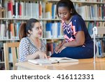 two beautiful girls studying in ... | Shutterstock . vector #416112331