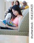 beautiful asian girl reading a... | Shutterstock . vector #416114425