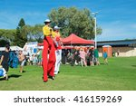 Juggling Stilt Walkers At...
