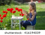 young artist painting flowers  | Shutterstock . vector #416194039
