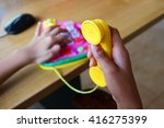 a girl plays a toy phone. | Shutterstock . vector #416275399
