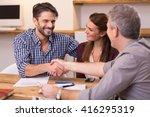 handshake of a mature manager... | Shutterstock . vector #416295319