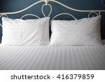 pillow on hotel bed | Shutterstock . vector #416379859