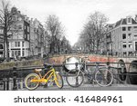 Stock photo bicycles parked on a bridge in amsterdam the netherlands 416484961