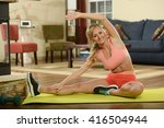 young woman working out on a... | Shutterstock . vector #416504944