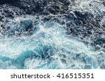 Sea Waves And Foam From A...