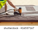 Construction Worker Putting Th...