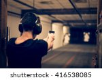 Man Aiming Pistol At Target In...