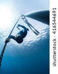 free diver descending along the ... | Shutterstock . vector #416544691