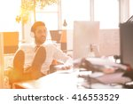 relaxed young businessman first ... | Shutterstock . vector #416553529