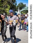 Small photo of BERKELEY, CA- Apr 16, 2016: Crowds of students at the University of California Berkeley campus during a Spring open house known as Cal Day. The Sather Gate entrance is seen in the background.