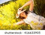 Happy Woman Lying Among Yellow...